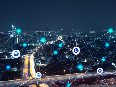 city at night with communication icons and network lines mix media concept background